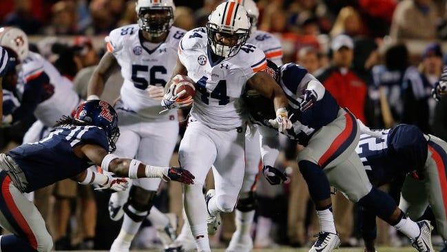 Auburn running back Cameron Artis-Payne gains yards against Ole Miss Saturday.