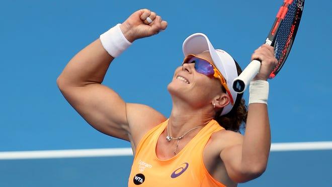 Australia's Samantha Stosur celebrates her win over Lucie Safarova in their match at the Sydney International. Stosur won the match 7-6, 5-7, 6-3.