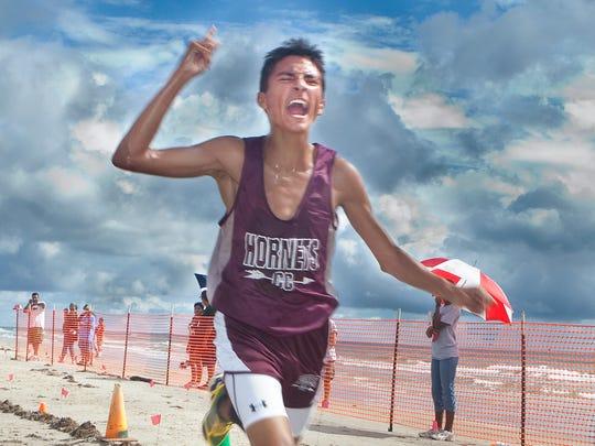 Flour Bluff senior Andre Fuqua, 17, celebrates crossing
