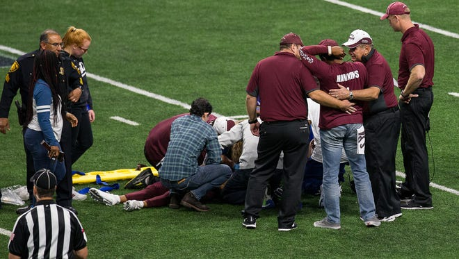 Trainers and EMS attend to Calallen's Zach Hawkins after a hard hit left him motionless on the field  during the third quarter of the Class 5A Division II state quarterfinal game against McCallum at the Alamodome in San Antonio on Saturday, Dec. 9, 2017.