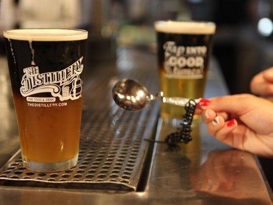 Far left, Black Velvet and Black Cherry beer cocktails, served at The Distillery on Mt. Hope Avenue.