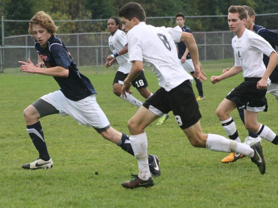 Plymouth's Nathan Harris (8) races Livonia Franklin's