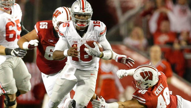 Ohio State quarterback J.T. Barrett rushed 21 times for 92 yards and two touchdowns and passed for 226 yards and a touchdown in the Buckeyes' 30-23 OT victory last season in Madison.