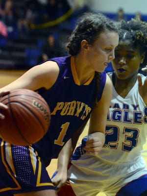Purvis High School player Kennedy Hudson rushes past the defense in a game against North Forrest High School on Tuesday.