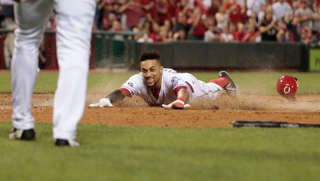 Cincinnati Reds center fielder Billy Hamilton (6) smiles at Cincinnati Reds shortstop Zack Cozart (2) as he scores in the fifth inning during the MLB game between the Milwaukee Brewers and the Cincinnati Reds, Saturday, May 7, 2016, at Great American Ball Park in Cincinnati.