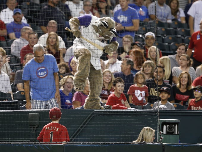 Diamondbacks' mascot Baxter playfully attempts to break