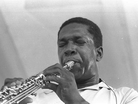John Coltrane performs at the Newport Jazz Festival.