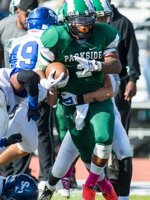 Parkside running back Trajon Branch (2) rushes against Stephen Decatur on Saturday afternoon at Wicomico County Stadium in Salisbury.