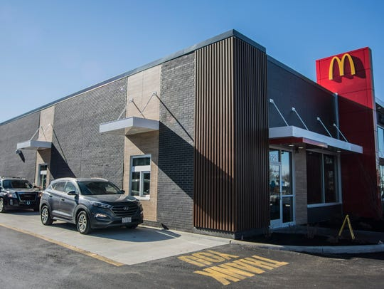 Cars wait for drive-thru orders at the newly constructed