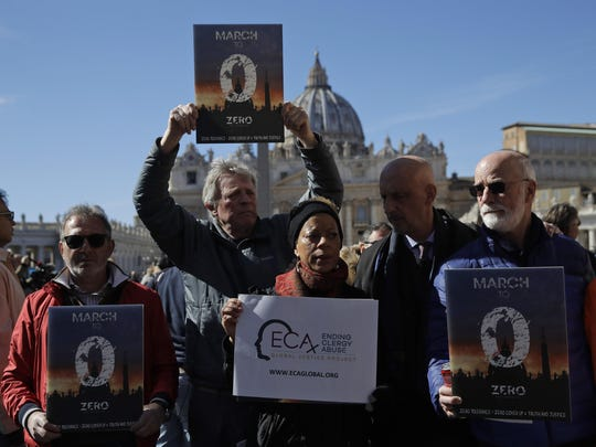 Sex abuse survivors and members of Ending Clergy Abuse show banners in front of St. Peter's Square at the Vatican, Sunday, Feb. 24, 2019.