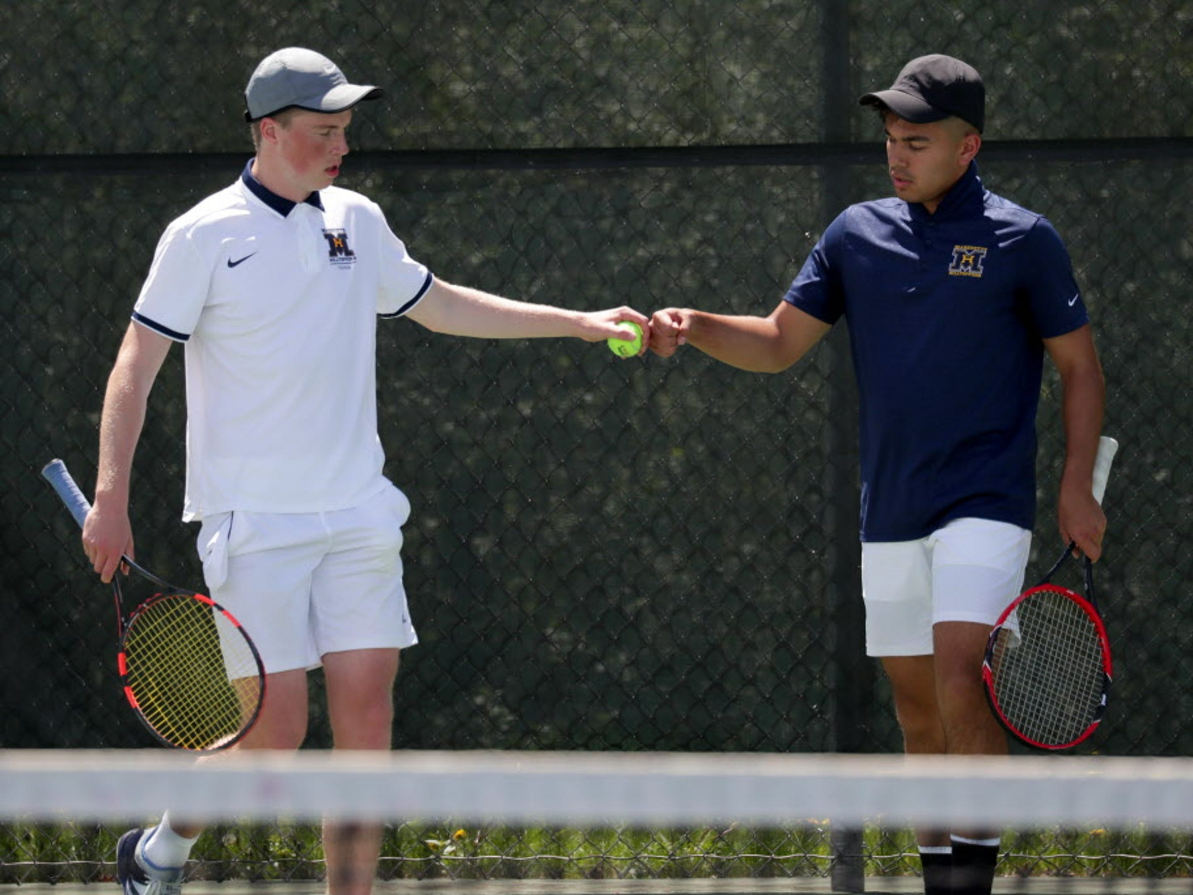 Marquette's doubles team of Noah Guillermo (right)