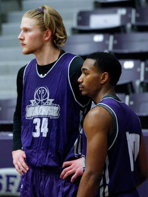 Stephen F. Austin Lumberjacks forward Jacob Parker (34) and guard Trey Pinkney (10) watch a drill during a practice at William R. Johnson Coliseum.