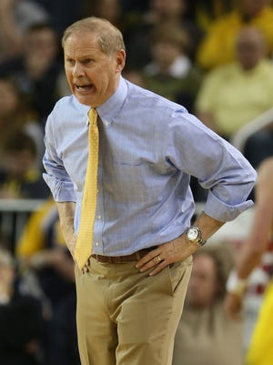Michigan's John Beilein on the bench during the second half of Tuesday's game against Michigan State.