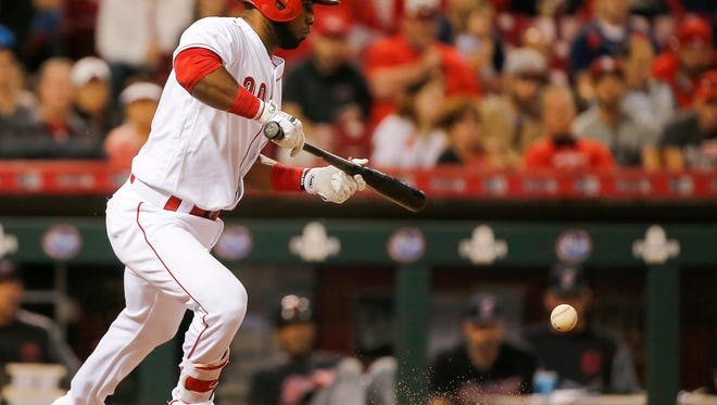 Cincinnati Reds second baseman Arismendy Alcantara (30) bunts in a run in the seventh inning during the interleague baseball game between the Cleveland Indians and the Cincinnati Reds, Monday, May 22, 2017, at Great American Ball Park in Cincinnati.