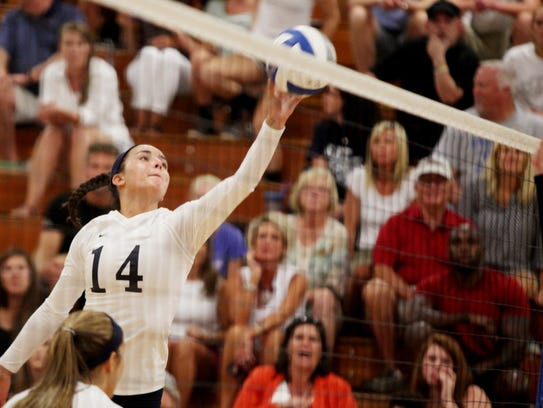 R.E. Lee's MacKensie Bowles taps the ball over the