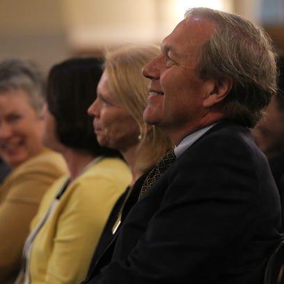 University of Iowa President Bruce Harreld listens
