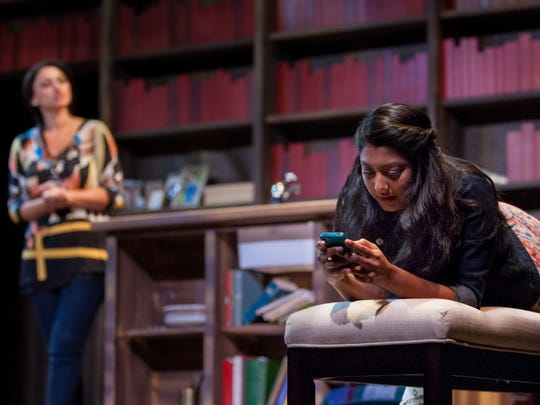 """Rasha Zamamiri, portraying Zarina, left, and Lipica Shah as her younger sister, Mahwish, right, trade opposing philosophies in the Gulfshore Playhouse's production of """"The Who and the What?"""""""