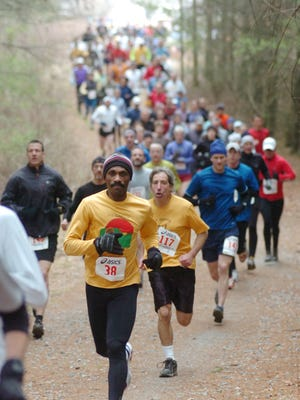 Runners compete in a past trail race at DuPont State Forest. Two upcoming trail races will be at DuPont.