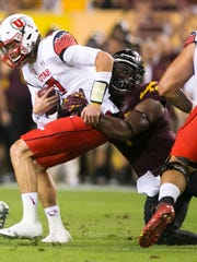 ASU defensive lineman Marcus Hardison sacks Utah quarterback Travis Wilson during the first quarter of the college football game at Sun Devil Stadium in Tempe on Saturday, November 1, 2014.