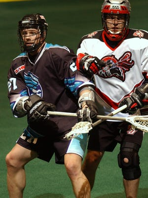 At left, former Knighthawks player Casey Zaph.