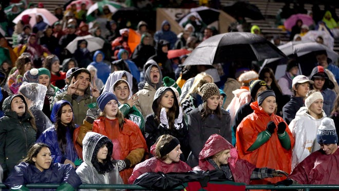 Wall fans brave the cold and the rain to cheer on the Hawks in a playoff game against Brock in 2016.