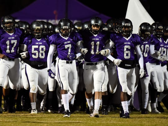Cane Ridge players walk onto he field before playing