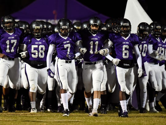 Cane Ridge players walk onto he field before playing Brentwood in an high school football game Friday, Nov. 10, 2017, in Antioch, Tenn.