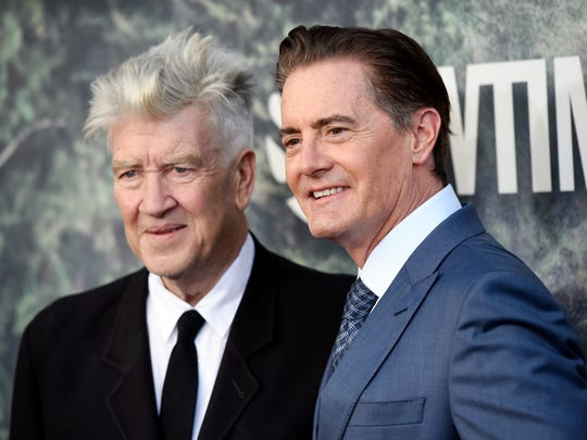 David Lynch, left, the co-creator, director and executive producer of 'Twin Peaks,' poses with Kyle MacLachlan at the premiere of the Showtime series at The Theatre at Ace Hotel on May 19, 2017, in Los Angeles.