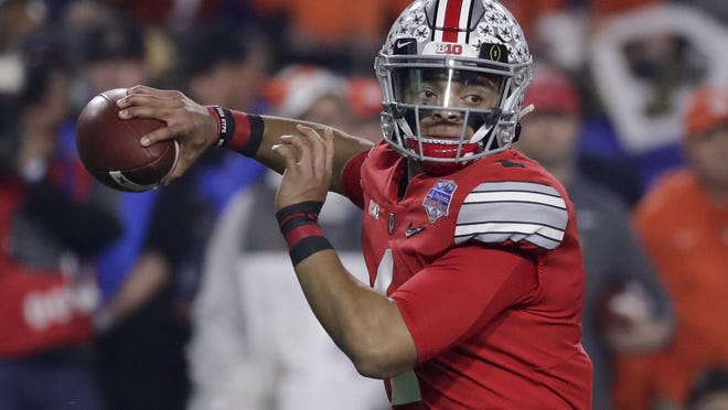Ohio State quarterback Justin Fields throws a pass against Clemson during the first half of the Fiesta Bowl on Dec. 28, 2019.