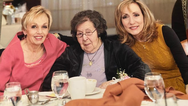 Mary Illuzzi, age 102, with her daughters Judy Tallo and Marian Fattore.