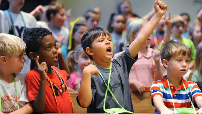 In this 2013 file photo, a group of youngsters joins together in song during the opening of Day 2 of Vacation Bible School at Madison United Methodist Church.