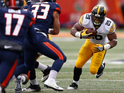 LeShun Daniels Jr. of the Iowa Hawkeyes runs the ball