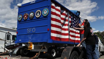 An SFO-bound special cart for fallen soldiers stops in Redding