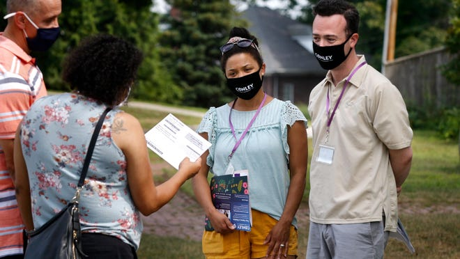 Dylan Conley and his wife, Jenica Reed Conley, greet Edgewood residents while out canvassing last Sunday in Cranston.