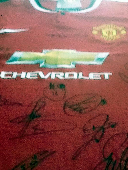 Manchester United of the Premier League provided an autographed jersey for the 5 Angels Memorial Tournament. The jersey includes the autograph of England national team member Wayne Rooney. Tournament organizers hope to have an auction for the jersey and other items with the proceeds headed to local youth soccer programs and a scholarship fund for New Oxford soccer players.