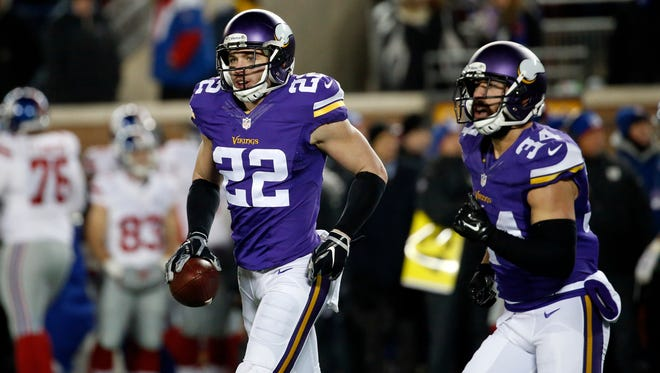 Minnesota Vikings free safety Harrison Smith holds his interception that he ran back for a touchdown against the New York Giants on Dec. 27, 2015.