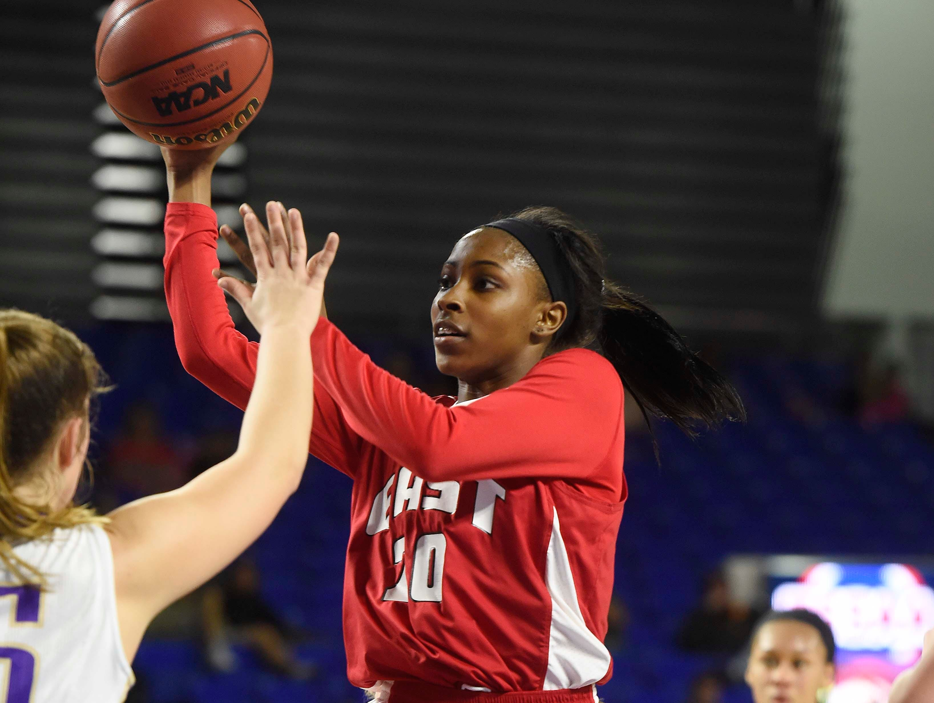 East's Erica Haynes-Overton (20) shoots for two as East Nashville leads 25-24 at the half n the Division I Class AA Girl's basketball tournament at the Murphy Center on MTSU's campus March 10, 2016 in Murfreesboro, Tenn.