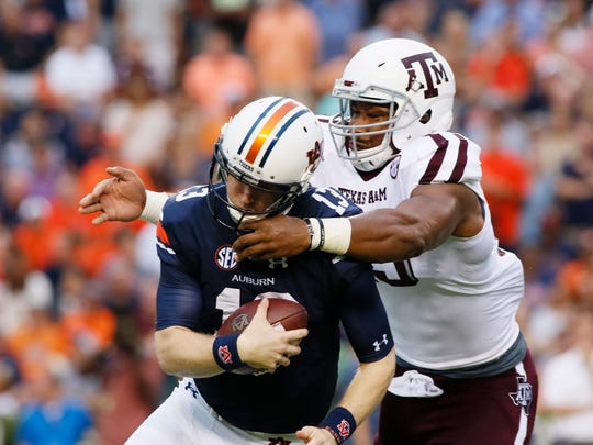 Texas A&M defensive lineman Myles Garrett (15) tackles