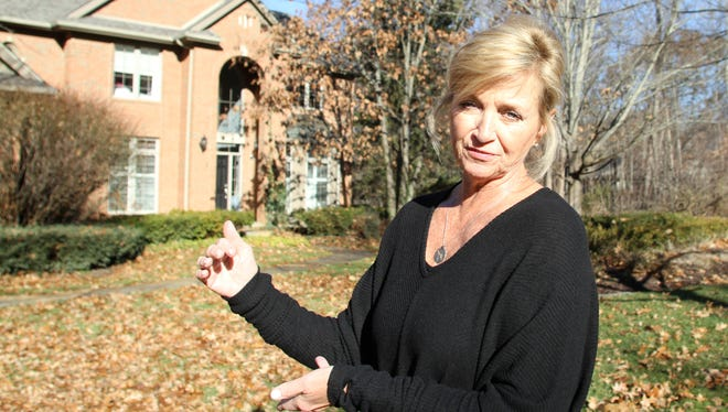 Ellen Moore, who lives in the Oaks at Beach Lake subdivision in Brighton Township, talks on Dec. 1, 2017 about the many ways her home, property and health have been affected by elevated levels of sodium chloride, allegedly leeched into ground water by excessive use at the nearby General Motors Milford Proving Ground.