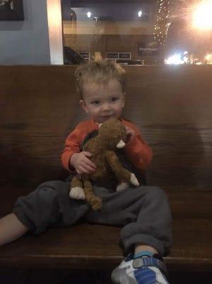Oscar Radaker, 2, was reunited with his Curious George stuffed toy on Thursday night.