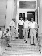 Roy Bryant, right, and his half-brother, J. W. Milam, second from right, walk down the steps of the Leflore County Courthouse in Greenwood, Miss., on Sept. 30, 1955, after being freed on bond in the kidnapping and murder of Emmett Till.