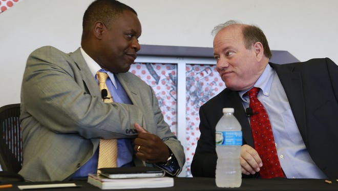 Detroit Emergency Manager Kevyn Orr, left, and Mayor Mike Duggan at Focus:Hope in Detroit in 2014.