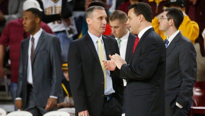 ASU head coach Bobby Hurley talks with Arizona head coach Sean Miller before the ASU-UA game in Tempe on January 3, 2016.