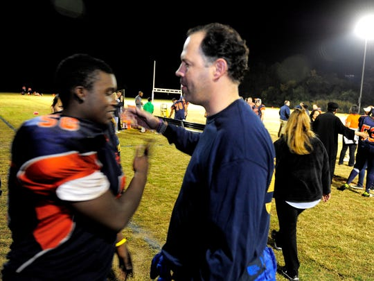 Malik Johnson and Chris Parker embrace on the sidelines Friday, Oct. 23, 2015, at Lighthouse Christian School in Nashville. Parker a former Predators executive vice president and chief sales and marketing officer, has been a mentor to Johnson for several years.