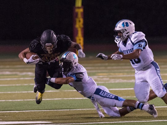 Tulare Union's Kazmeir Allen dives for extra yards