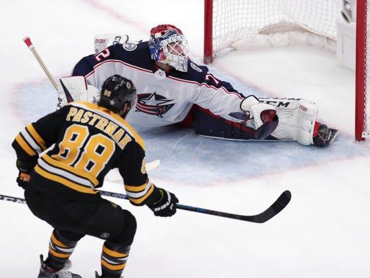Bruins right wing David Pastrnak beats Blue Jackets