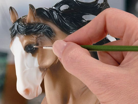 A Breyer artisan hand-paints the fine details of every model.