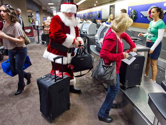 Holiday travelers, including Donald Occimio of Mesa,