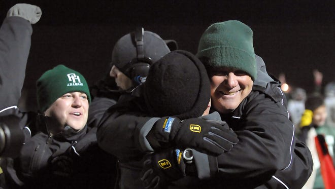 Pendleton Heights' Head Coach, John Broughton (R), celebrates after winning the Greenfield-Central / Pendleton Heights football sectional championship game, Friday evening, November 5, 2010.  Walt Winter / For The Star.