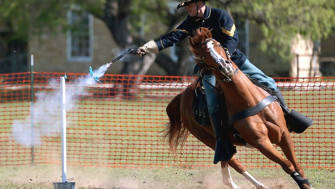Riders competing in the Regional Cavalry Competition at Fort Concho National Historic Landmark try to hit balloon targets from horseback in 2016.